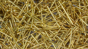Small decorative nails. Decorative gilt pins for jewelry production stock photography