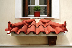 Small decorative roof below the window Royalty Free Stock Image