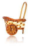 Small decorative stroller. Small decorative souvenir straw basket isolated on white background Stock Photography
