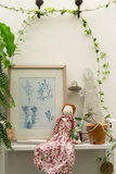 Small decorative vintage tree, doll and frame Stock Photos