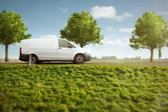 Small delivery van on a country road stock image
