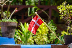 Small Denmark flag for decorations. At a garden. Close up Royalty Free Stock Photography