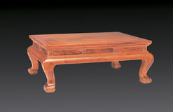 A small desk of Ming-stye. A small desk belongs to Chinese classical furniture of Ming-style, it is made by Huanghuali wood,which is cherish now Royalty Free Stock Image