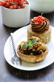 Small dessert pastries with nuts and berries Royalty Free Stock Photo