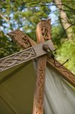 The small detail of a viking tent. The small carved wooden detail of a viking tent stock image