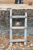 Small diagonal wooden ladder Royalty Free Stock Photography