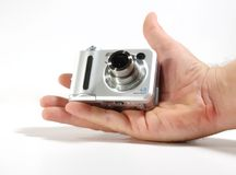 Small digital camera. A hand holding a small digital camera Stock Photography