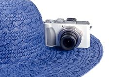 Small Digital Camera and Straw Hat Royalty Free Stock Image