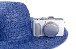 Small Digital Camera and Straw Hat Royalty Free Stock Photography