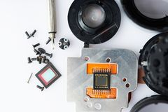 Small digtial parts of modern camera. Lay on white table. Broken electronic device service Royalty Free Stock Photo