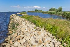 Small dike at the Schildmeer lake in Groningen. Holland stock photography