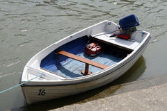 A small dinghy boat on a tidal sea river. A small motor boat waiting to ferry passengers across a tidal river Stock Images