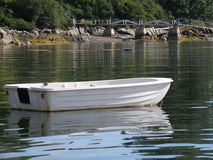 Small Dinghy in the Water on a Mooring in Casco Bay stock image