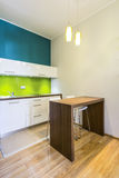 Small dining space in green kitchen Royalty Free Stock Images