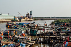 Small dirty river with boats and bridges in Asia royalty free stock photo
