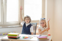 Small disciples on the lesson at school. Stock Photos