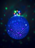 Small disco ball with lights behind Royalty Free Stock Photography