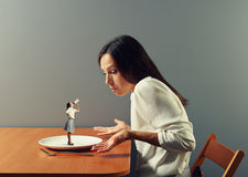 Small discontented woman screaming. At big businesswoman stock image