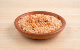 Small dish filled with salt, red chili pepper and paprika Stock Image