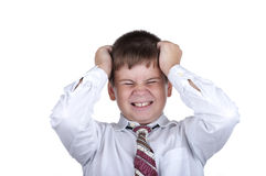 The small dissatisfied boy. On a white background Royalty Free Stock Photo