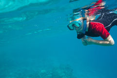 Small diver. Underwater with mask Stock Photo