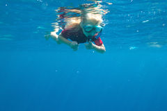 Small diver. A small diver swimming underwater Stock Photography