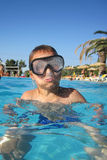 Small diver boy. In the blue water Stock Photos