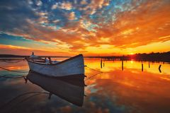 Free Small Dock And Boat At The Lake Royalty Free Stock Photos - 116665138