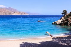 Small dock in apollo beach. At island karpathos greece. summer time Stock Images