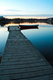 Small dock and a boat Royalty Free Stock Images
