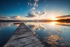 Small Dock and Boat at the lake Royalty Free Stock Images