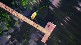 Small Dock and Boat at the lake. Aerial view Royalty Free Stock Photos