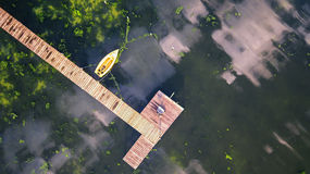 Small Dock and Boat at the lake. Aerial view Royalty Free Stock Image