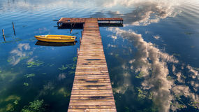 Small Dock and Boat at the lake. Aerial view Royalty Free Stock Photo