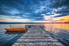 Small Dock and Boat at the lake Royalty Free Stock Photography