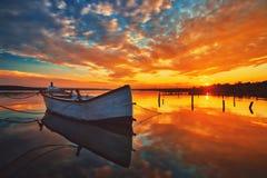 Small Dock and Boat at the lake. Sunset shot royalty free stock photos