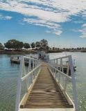 Small dock and boat stock photography
