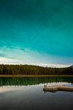 Small dock. Under a turquoise sky on a lonely lake Royalty Free Stock Photos