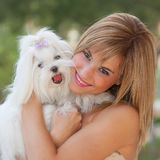 Small dog with owner. Small dog with happy owner woman Royalty Free Stock Photo