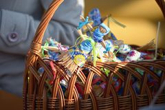 Small dolls from straw in a basket at a fair Royalty Free Stock Photography