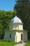 Small domed chapel. A view of a small, domed chapel or church in a corner of a park in Romania Stock Images