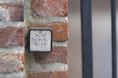 Door access controller. Small door access controller on a red brick wall Royalty Free Stock Photo