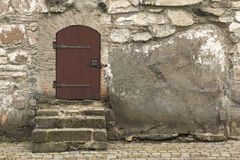 Small door. Set in rough stone wall Stock Photo