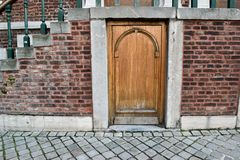Small door under stairway. Of an ancient building Royalty Free Stock Image