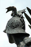Small dragon on a helmet. Detail on a public statue in Arad, Rom Stock Images