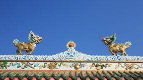 Small dragon status on chinese temple roof Royalty Free Stock Image