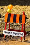 A small drainage operations obstruction sign in spring.  Stock Photo