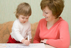 Small drawing girl with mother Stock Photo