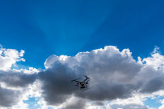 Small drone and dark clouds Stock Photo