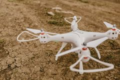 Small drone with digital camera just before the start on the gr stock images